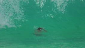 High waves on Karon Beach, Phuket. THAILAND, PHUKET - NOVEMBER 19, 2015: Tourists having fun swimming in high waves on Karon Beach, Phuket, Thailand stock video footage