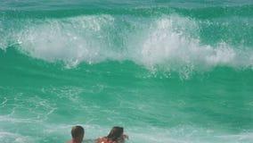 High waves on Karon Beach, Phuket. THAILAND, PHUKET - NOVEMBER 19, 2015: Tourists having fun swimming in high waves on Karon Beach, Phuket, Thailand stock video