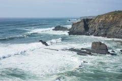 Atlantic ocean coast with rugged cliffs near Odeceixe, Alentejo, Portugal stock image