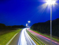 High way. Highway traffic at night with line made from lighting Royalty Free Stock Photos