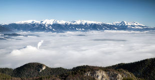 High and West Tatras from hill Maline, Slovakia. Beautiful winter landscape and inversion layer. West and High Tatras from Malino Brdo, Slovakia Stock Photo