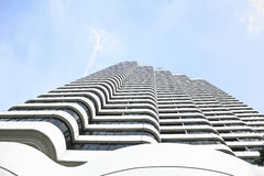 High white building in the sky.Bottom view. Stock Image