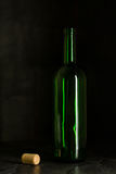 High wine glass made from green glass. No content. Glass and cork. Low key. Stock Image