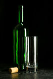 High wine glass made from green glass. No content. Glass and cork. Low key. Stock Photography