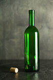 High wine glass made from green glass. No content. Glass and cork. Low key. Stock Images