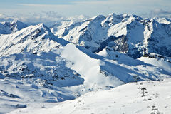 High winter snowy mountains Stock Images