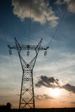 High woltage pylons with wires and sunset Royalty Free Stock Image