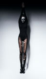 High woman in skull make-up and pantyhose. In studio Royalty Free Stock Image