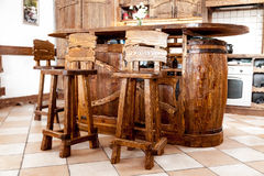 high wooden bar chairs standing near bar desk Royalty Free Stock Photo
