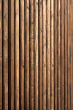 High wooden fence. Wall made of old wood planks Stock Photo