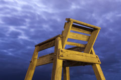 High wooden lifesaver chair. On tropical sandy deserted beach night shoot Stock Photography