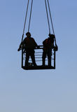 High working persons. Workers in a elevating basket Royalty Free Stock Photos
