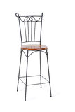 High wrought-iron chair with wooden seat isolated Royalty Free Stock Image