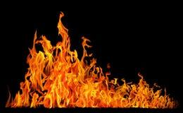 High yellow fire on black Stock Photos