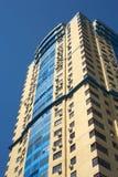 High yellow modern multi-storey building on blue c Royalty Free Stock Photos