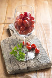 Highball cup with grape tomatoes Royalty Free Stock Image