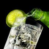 Highball Glass. Liquid pouring into a highball glass Stock Photo