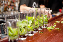 Highball glasses with mint - preparing mojitas Royalty Free Stock Photography