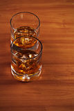 Highball whiskey glass with ice and lemon. Stock Photos