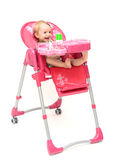 Highchair met baby Stock Foto's
