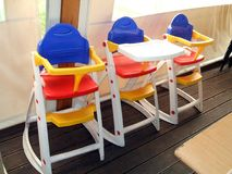 Highchairs for children. booster seats. Highchairs or booster seats in a public place for the children of the customers Royalty Free Stock Images