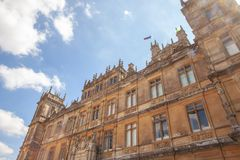 Highclere Castle famous as downton abbey in newbury England. Highclere Castle famous as downton abbey in the English county of Hampshire Royalty Free Stock Image