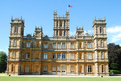 Highclere Castle, known popularly as Downton Abbey. Highclere Castle is a country house in the Jacobean style, with a park designed by Capability Brown. The 5 Royalty Free Stock Photo