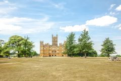Highclere castle with park and green trees newbury England. Highclere castle famous as downton abbey with park and green trees newbury England Stock Image