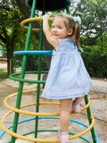 Higher and higher. A girl plays on short flight of stair as a rocket Royalty Free Stock Images