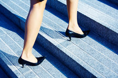 Higher Level. Businesswoman walking up stairs to higher level Stock Photos