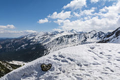 Higher parts of the mountains in the spring are still in the snow Royalty Free Stock Photography