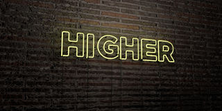 HIGHER -Realistic Neon Sign on Brick Wall background - 3D rendered royalty free stock image Royalty Free Stock Images