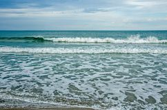 Green and White Waves Rolling and Splashing Royalty Free Stock Photography