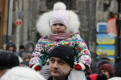 Higher than all. The photo of the child's father at Market Square in Lviv Stock Photos