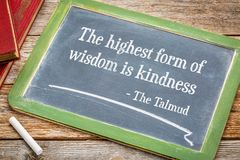 The highest form of wisdom is kindness. Talmund quote - white chalk text on a slate blackboard Royalty Free Stock Image