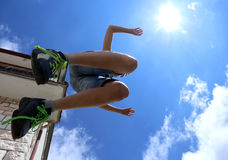 Highest jump of a child and the blue sky Stock Photos