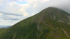 Highest mountain peak covered clouds. stock footage