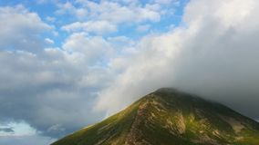 Highest mountain peak covered clouds. stock video footage