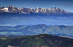 Highest summits of High Tatras, the Carpathians and Slovakia. Gerlachovsky, Ladovy and Lomnicky peaks, in a sunny spring day from Kralova Hola peak, Low Tatras Stock Photo