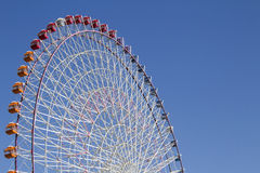 The highest Tempozan Gaint Ferris Wheel (Daikanransha) in the clear sky. At Osaka,Japan; This farris wheel have many colorful 60 cabins and some can see-through Stock Photos
