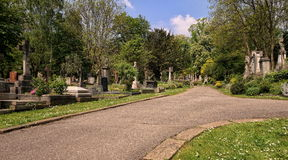 HIGHGATE, LONDON, UK - March 12, 2016: Path leading through the East Cemetery Stock Images