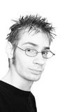 Highkey portrait of youth. Highkey black and white portrait of a young adult with a cliche look of a tech (spiky hair and glasses) isolated on white background stock image