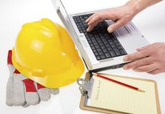 Construction Plans on Laptop with Hardhat Stock Photography