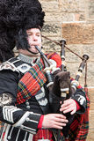 A highland Bagpiper performing in Edinburgh Square Stock Photos