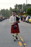 Highland Bagpiper. Single highland bagpiper leading parade Royalty Free Stock Photography