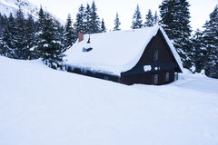 Highland cottage in the snow Royalty Free Stock Photo