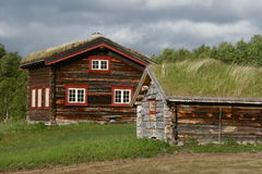 Highland farm. Two old unpainted wooden houses on a highland farm Royalty Free Stock Photography