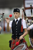 Highland Games in Scotland. A young drummer in a pipe band at the Cowal Gathering Highland Games near Dunoon on the Cowal Peninsula in Scotland. The Highland Royalty Free Stock Photos