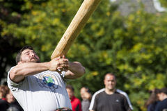 Highland games scotland. A caber toss is one of many competition of the highland games held all around scotland.the competitors must to run forwardwith the pine Royalty Free Stock Images