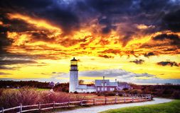 Highland Lighthouse Sunset cape cod. The Highland Lighthouse against a beautiful dramatic sunset in North Truro Massachusetts on the Cape Cod National Seashore royalty free stock image